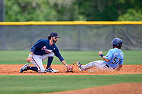 Atlanta Braves Braden Shewmake (73) tags Jake Palomaki (57) sliding in during a Minor League Spring Training game against the Tampa Bay Rays on April 25, 2021 at Charlotte Sports Park in Port Charlotte, Fla.  (Mike Janes/Four Seam Images)