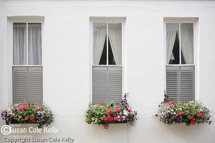 Three windows in the Battery district,  Charleston, SC