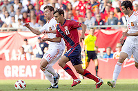 USA forward Chris Wondolowski (11) dribbles as Spain midfielder Xabi Alonso (14) defends. In a friendly match, Spain defeated USA, 4-0, at Gillette Stadium on June 4, 2011.