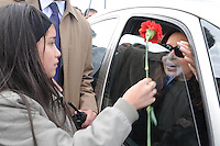 A girl gives a flower to  President of  Argentina  Cristina Fernandez at her arrival  at Rio Gallegos for the  funeral of her husband Nestor Kirchner, Friday, October 29, 2010..Photo Presidential Office
