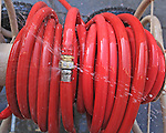 A colorful leaky garden hose