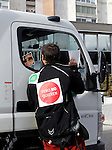 Anti-eviction activist hold placard and talk to a driver during an 'escrache'  outside popular party deputy and defense comission spokeswoman Beatriz Rodriguez-Salmones house in Madrid on April 11, 2013 in Madrid, Spain. Placard reads ' Yes we can but they don't want'. The Mortgage Holders Platform (PAH) and other anti evictions organizations have been organizing 'escraches' for several weeks under the slogan 'There are lives at risk' to claim the vote for a Popular Legislative Initiative (ILP) to stop evictions and facilitate social rent, outside Popular Party deputies' houses and offices. 'Escraches' are a form of peaceful protest that were used in Argentine in 1995 to publically denounce pardoned members of the dictatorship for their crimes at their doorsteps(ALTERPHOTOS/Alconada)