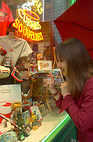 June 16 , 2002, Montreal, Quebec, Canada<br /> <br /> A Japanese tourist look at souvenir items in a Old Montreal shop window , June 16 , 2002.<br /> <br /> Model released for all usages.<br /> <br /> Mandatory Credit: Photo by Pierre Roussel- Images Distribution. (©) Copyright 2002 by Pierre Roussel <br /> <br /> NOTE Nikon D-1 jpeg opened with Qimage icc profile, saved in Adobe 1998 RGB. Original size - uncropped TIFF file available on request.