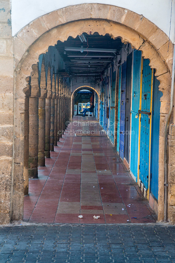 Essaouira, Morocco.  Early Morning Arcade of Shops not yet open  along Avenue Mohamed Zerktouni in the Medina.