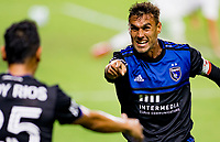 CARSON, CA - OCTOBER 14: Andres Rios #25 of the San Jose Earthquakes scores a goal and celebrates with team mate Chris Wondolowski #8 during a game between San Jose Earthquakes and Los Angeles Galaxy at Dignity Heath Sports Park on October 14, 2020 in Carson, California.