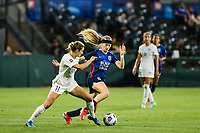 TACOMA, WA - JULY 31: Bethany Balcer #24 of the OL Reign battles for the ball during a game between Racing Louisville FC and OL Reign at Cheney Stadium on July 31, 2021 in Tacoma, Washington.