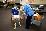 St Johnstone v Fleetwood Town…24.07.21  McDiarmid Park<br />Reece Devine pictured receiving his Covid-19 vaccination from nurse Fiona Little<br />Picture by Graeme Hart.<br />Copyright Perthshire Picture Agency<br />Tel: 01738 623350  Mobile: 07990 594431