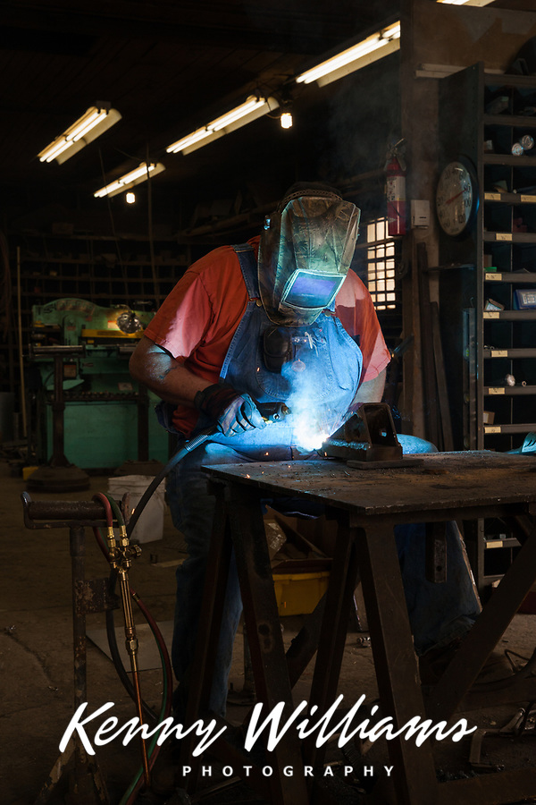 Blacksmith welding and repairing farm equipment, Amira, Eastern Washington State, WA, America, USA.