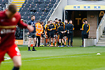 Hull players waiting to warm up seem to be enjoying Sunderland players going through their pre match routine. Hull 2 Sunderland 2, League One 20th April 2021.