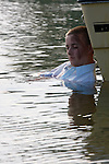 A boating accident victim in the water next to the boat