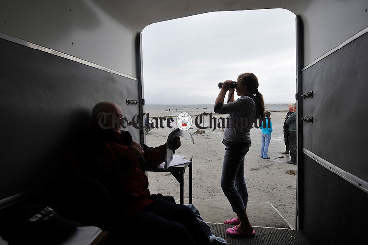 Eugene Costello looks after the entries as Marie Mc Mahon keeps an eye on the competitors at the Leon Currach Regatta at Seafield, Quilty. Photograph by John Kelly.