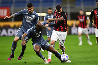 Bryan Dabo of Benevento Calcio and Theo Hernandez of AC Milan compete for the ball during the Serie A football match between AC Milan and Benevento Calcio at San Siro Stadium in Milano  (Italy), May 1st, 2021. Photo Matteo Gribaudi / Image Sport / Insidefoto