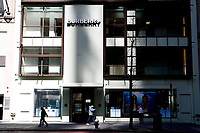 NEW YORK, NEW YORK - MARCH 12: People walk in front the Burberry store on March 12, 2021 in New York. Burberry expects full-year profits to beat market forecasts after a rebound in sales in the fourth quarter, sending its shares more than 6% higher. (Photo by Emaz/VIEWpress)