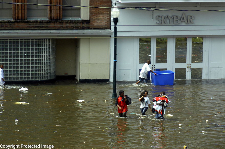 Looters cross Canal Street in New Orleans after Hurricane Katrina, New Orleans, August 31, 2005..