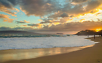 Beach-goers take in the last of the sunset at Big Beach at Makena State Park, Maui.