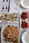 A lunch of bruschetta, swordfish carpaccio and seafood risotto at Peppino Restaurant in the township of Sant' Angelo in the southern end of Ischia island in the Tyrrhenian Sea, at the northern end of the Gulf of Naples.
