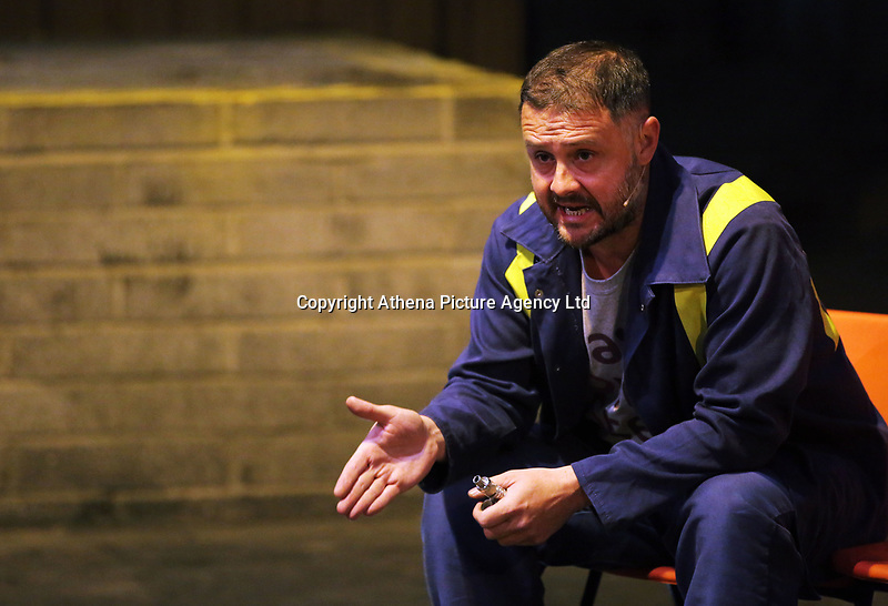 """Pictured: Actor Simon Nehan<br /> Re: Press rehearsal of """"We'Re Still Here"""", a play created by Rachel Trezise, Common Wealth and the National Theatre Wales about steelworkers, which will be performed in Byass Works, a disused industrial unit, in Port Talbot, south Wales, UK."""