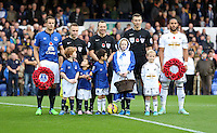 Liverpool, UK. Saturday 01 November 2014<br /> Pictured: Team captains Ashley WIlliams (R) holding wreaths, with match officials and children mascots.<br /> Re: Premier League Everton v Swansea City FC at Goodison Park, Liverpool, Merseyside, UK.