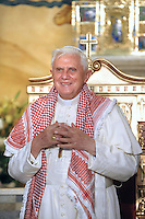 Pope Benedict XVI wears a traditional Jordanian 'Kaffiyeh' during his visit to the Lady of Peace Church in Amman, Jordan Friday, May 8, 2009..