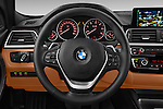 Car pictures of steering wheel view of a 2016 BMW 3 Series Luxury 4 Door Sedan Steering Wheel