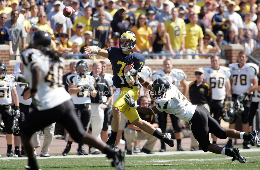 1 September 2007: Michigan quarterback Chad Henne (7) throws the ball, which resulted in an interception, in the 2007 season opener college football game between the Michigan Wolverines and Appalachian State Mountaineers at Michigan Stadium in Ann Arbor, MI. No. 5 ranked Michigan was upset 32-34.