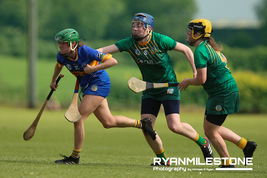 Tipperary's Casey Hennessy in action against Grace Coleman and Maeve Clince of Meath during the Liberty Insurance All Ireland Senior Camogie Championship Round 1 between Tipperary and Meath at the Ragg, Co Tipperary. Photo By Michael P Ryan.