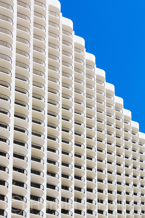 Great symmetry in the architectural design of hotel balconies along Waikiki Beach in Oahu, Hawaii.