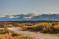 Vehicles travel the Richardson Highway through the Alaska Range mountains, Interior, Alaska.