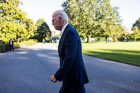 United States President Joe Biden walks away after answering a few questions from reporters as he and first lady Dr. Jill Biden return to the White House in Washington, DC, USA, from Camp David, the presidential retreat near Thurmont, Maryland,  26 September 2021.<br /> Credit: Jim LoScalzo / Pool via CNP /MediaPunch
