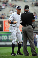 New York Yankees infielder Alex Rodriguez #13 with 3rd base umpire John Hirshbeck during a game against the Tampa Bay Rays at Yankee Stadium on September 21, 2011 in Bronx, NY.  Yankees defeated Rays 4-2.  Tomasso DeRosa/Four Seam Images