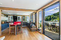 BNPS.co.uk (01202) 558833<br /> Pic: MarchandPetit/BNPS<br /> <br /> Pictured: The kitchen.<br /> <br /> A stunning contemporary home just a stone's throw from an idyllic beach is on the market for £3.85m.<br /> <br /> The aptly-named Beach House was designed to take advantage of its breath-taking views over North Sands Beach and out to sea.<br /> <br /> The four-bedroom oak-framed house is in a fantastic plot in one of the most sought after locations in Salcombe, Devon.<br /> <br /> As well as an expansive balcony to enjoy the views, it also has boat storage - a rarity in the town.