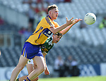 Jack Reidy of Clare in action against Kevin Keane of Clare during their Munster Minor football final at Pairc Ui Chaoimh. Photograph by John Kelly.