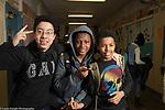 Education High School 3 boys posing in corridor