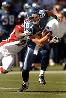 Sep 25, 2005; Seattle, WA, USA; Seattle Seahawks wide receiver #87 Joe Jurevicius is grabbed by an Arizona Cardinals defender in the second quarter at Qwest Field. Mandatory Credit: Photo By Mark J. Rebilas