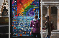 BNPS.co.uk (01202) 558833<br /> Pic: ZacharyCulpin/BNPS<br /> <br /> 8 million stitches, 1 Holy Exhibition<br /> <br /> Pictured: Cathedral visitors with an embroidery entitled, 'Water and sky – splash with colour!'<br /> from Genesis 1.20-23<br /> <br /> Twelve large embroidered panels fashioned from eight million stitches which tell the story of 'the Creation' have gone on display at Salisbury Cathedral.<br /> <br /> The panels, which measure up to 8ft by 11ft, are made from silk, hand-dyed materials, gold leaf and metallic leathers.<br /> <br /> They have been created by Devon-based textile artist Jacqui Parkinson who has dedicated three years to the solo project.<br /> <br /> The panels are inspired by the poetic verses of Genesis, the first book in the Bible, and include depictions of the Garden of Eden.