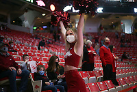 An Arkansas cheerleader cheers, Saturday, January 9, 2021 during the first half of a basketball game at Bud Walton Arena in Fayetteville. Check out nwaonline.com/210110Daily/ for today's photo gallery. <br /> (NWA Democrat-Gazette/Charlie Kaijo)