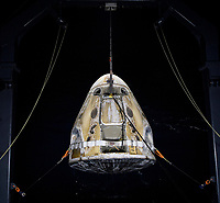 The SpaceX Crew Dragon Resilience spacecraft is lifted onto the GO Navigator recovery ship after it landed with NASA astronauts Mike Hopkins, Shannon Walker, and Victor Glover, and Japan Aerospace Exploration Agency (JAXA) astronaut Soichi Noguchi aboard in the Gulf of Mexico off the coast of Panama City, Florida, Sunday, May 2, 2021.  NASA's SpaceX Crew-1 mission was the first crew rotation flight of the SpaceX Crew Dragon spacecraft and Falcon 9 rocket with astronauts to the International Space Station as part of the agency's Commercial Crew Program. <br /> Mandatory Credit: Bill Ingalls / NASA via CNP / MediaPunch