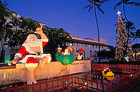 Twilight view of Hawaiian Santa  & Christmas tree at Honolulu Hale
