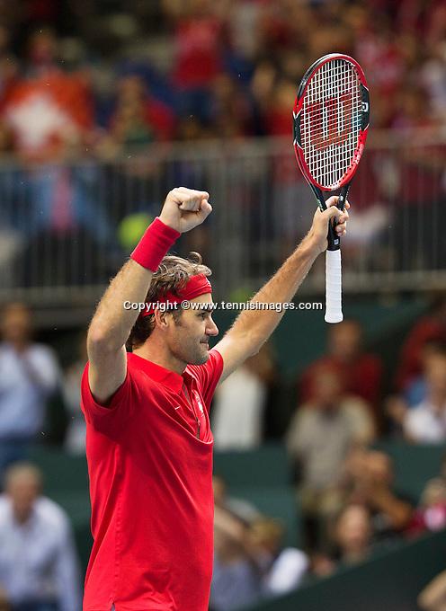 Switserland, Genève, September 20, 2015, Tennis,   Davis Cup, Switserland-Netherlands, Roger Federer (SUI) wins the deciding point and celebrates<br /> Photo: Tennisimages/Henk Koster