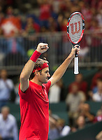 Switserland, Genève, September 20, 2015, Tennis,   Davis Cup, Switserland-Netherlands, Roger Federer (SUI) wins the deciding point and celebrates<br /> Photo: Tennisimages/Henk Koster