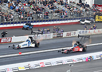 Feb 9, 2020; Pomona, CA, USA; NHRA top fuel driver Leah Pruett (left) races alongside Shawn Reed during the Winternationals at Auto Club Raceway at Pomona. Mandatory Credit: Mark J. Rebilas-USA TODAY Sports
