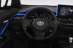 Car pictures of steering wheel view of a 2018 Toyota C-HR C-LUB hybrid 5 Door SUV