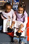 Preschool pretend play two girls feeding dolls bottles substituting cylinder blocks for bottles vertical