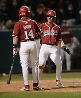 Arkansas right fielder Cayden Wallace (7) celebrates Friday, April 2, 2021, with third baseman Cullen Smith after Wallace scored the go-ahead run on a wild pitch during the eighth inning of play against Auburn at Baum-Walker Stadium in Fayetteville. Visit nwaonline.com/210403Daily/ for today's photo gallery. <br /> (NWA Democrat-Gazette/Andy Shupe)
