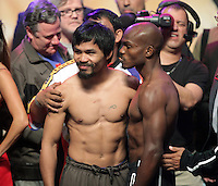 Boxers Manny Pacquiao,L, and Timothy Bradley ,R, pose during the weigh-in Friday June 8, 2012, for their bout at the MGM Grand Hotel/Casino in Las Vegas, Nevada. Pacquiao weigh-in at 147 lbs. Bradley weighed- in at 146 lbs. Pacquiao will defend his WBO welterweight title against Bradley when the two meet in the ring on June 9 at the MGM Grand Garden Arena in Las Vegas.  Photo John Gurzinski