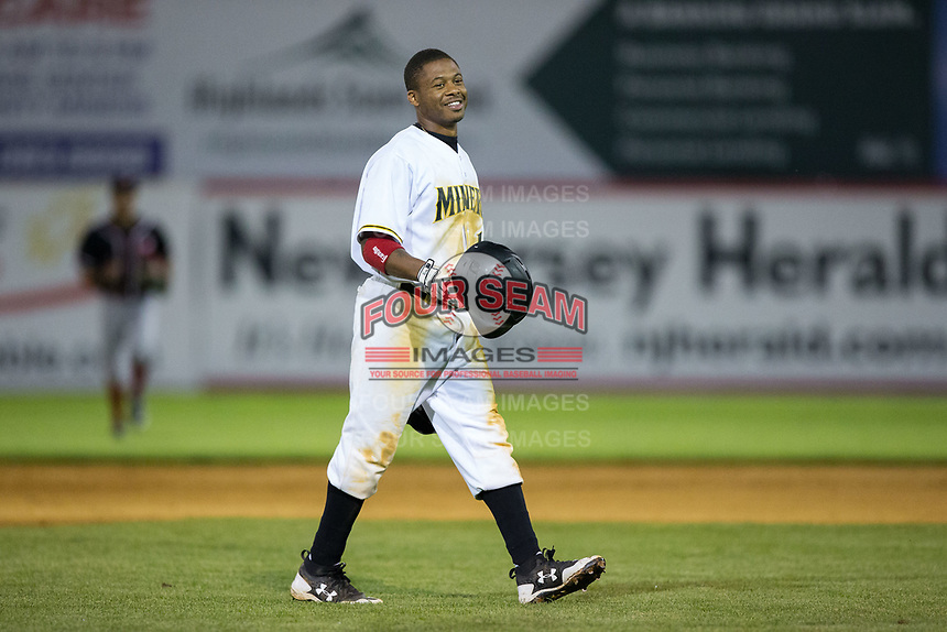 Adron Chambers (1) of the Sussex County Miners walks back to the dugout following the third out of the 8th inning against the New Jersey Jackals at Skylands Stadium on July 29, 2017 in Augusta, New Jersey.  The Miners defeated the Jackals 7-0.  (Brian Westerholt/Four Seam Images)