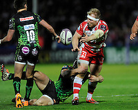 Matt Kvesic of Gloucester Rugby offloads past Henry Slade of Exeter Chiefs during the European Rugby Challenge Cup semi final match between Gloucester Rugby and Exeter Chiefs at Kingsholm Stadium on Saturday 18th April 2015 (Photo by Rob Munro)