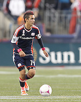 New England Revolution midfielder Diego Fagundez (14) brings the ball forward. In a Major League Soccer (MLS) match, the New England Revolution (blue) defeated Chicago Fire (red), 1-0, at Gillette Stadium on October 20, 2012.