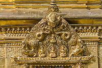 Nepal, Kathmandu, Swayambhunath.  Decoration on Buddhist Shrine at Base of Main Stupa.