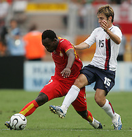 U.S. midfielder (15) Bobby Convey tries to take the ball away from Ghana midfielder (8) Michael Essien. Ghana defeated the USA 2-1 in their FIFA World Cup Group E match at Franken-Stadion, Nuremberg, Germany, June 22, 2006. Ghana advances to round of 16 and the USA is out of the tournament.